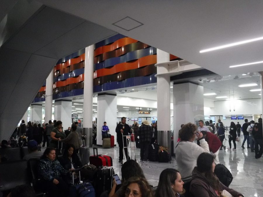 People waiting for their loved ones or ready to leave for their flight at the Miguel Hidalgo International Airport in Guadalajara. Photo by Carolina Puga Mendoza on March 26.