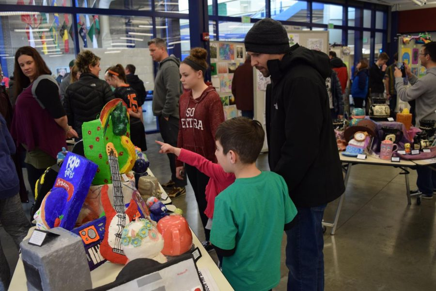 Families roam HSE looking at different pieces from every school in Hamilton county at the district art show on March 17. Photo by Mo Wood.
