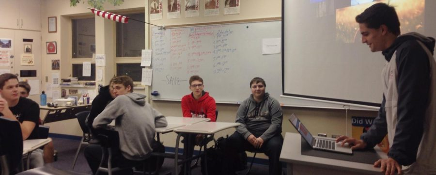 Junior Mason McCartney discusses the political highlights of the week with the Teenage Republicans Club attendees in B208 on Feb 27. Photo by Helen Rummel.