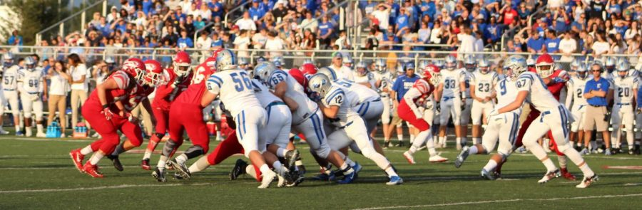 Students watch the annual Mudsock game between the Tigers and the HSE Royals on Sept. 8. Tigers win 20-14. Photo by Mia Morales.