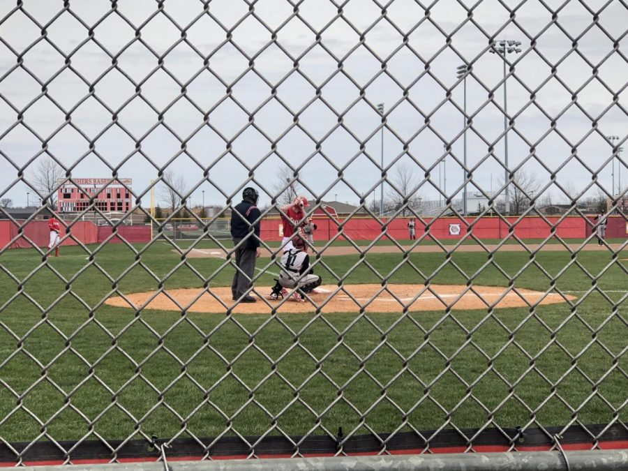 Freshman Zach Pearson waits for the pitch at home plate against North Central on April 21. Tigers lose 14-3. Photo by Zoie Soehngen.