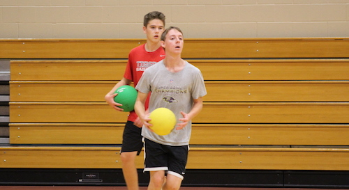 Juniors Brian Conaway (front) and Jordan Guler (back) size up their competition as they charge to meet them at the half court line. Photo by Sarah Peterson.
