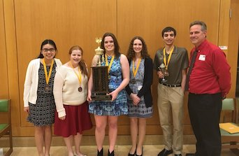 (Left to right) Juniors Tiffany Le, Rebekah White, senior Sarah Hiatt, junior Hope Fury, sophomore Collin Tully and math teacher John Drozd hold the FHS team trophy for the competition. Photo used with permission of John Drozd.