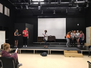 """Junior Hailey Davis (lower left hand corner) directs theater students in the play """"Where the Wild Things Are"""" on May 7. Photo by Sydney Greenwood."""