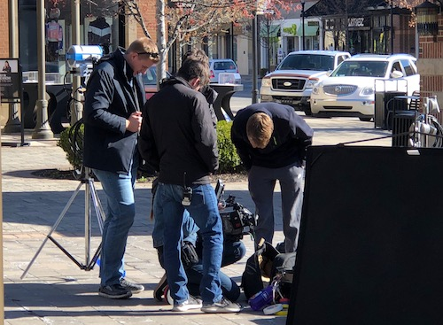 Film production club members freshman Patrick Nusbam, senior Carter Hoffman and sophomore Ben Johnson learn how to work a professional camera on the set of Project Pigasus on April 29. Photo used with permission of Ben Schwartz.