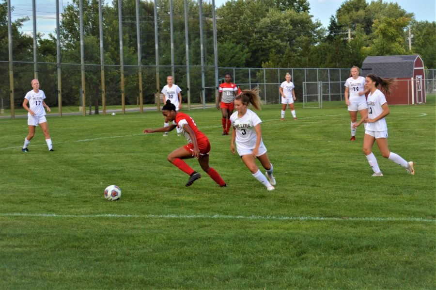 Junior Taryn McFarland takes the ball away from the sideline, but the Millers keep all of her exits covered in a 5-2 finish on Aug,29.