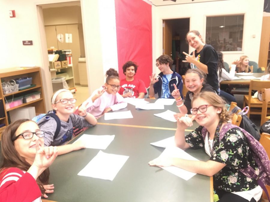 Sand Creek Intermediate fifth and sixth graders learn to spell their name in sign on Sept. 11, 2018