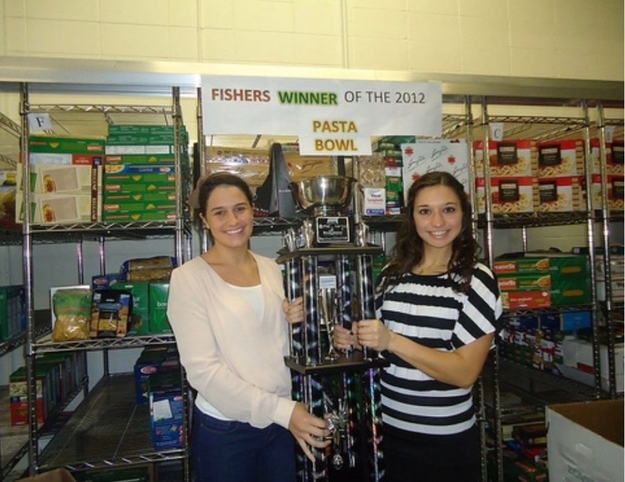 Katie Lipke and Erin Lattimer holding the Pasta Bowl trophy at Second Helpings to celebrate their first victory in 2012.