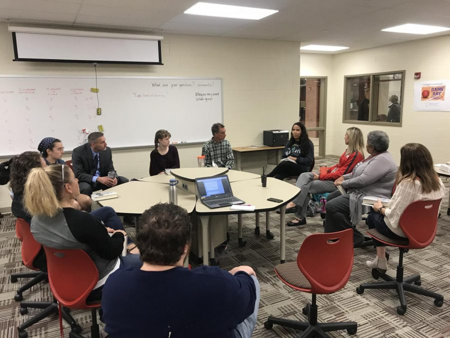 Gathered around a large table on Thursday, September 27 in H136, the members of the book club including a mixture of staff and students, discuss their interpretations of The Hate U Give, and let discussions of race take center stage.