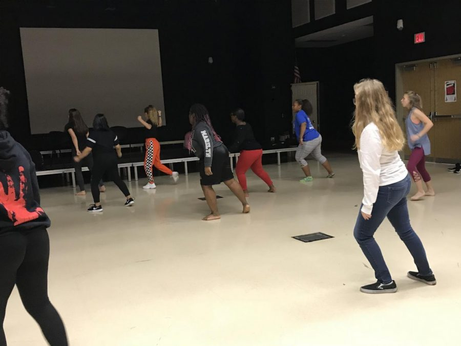 Members of the Dance Explosion club practice choreography for one of their first shows in the black box theater after school on Oct. 24.