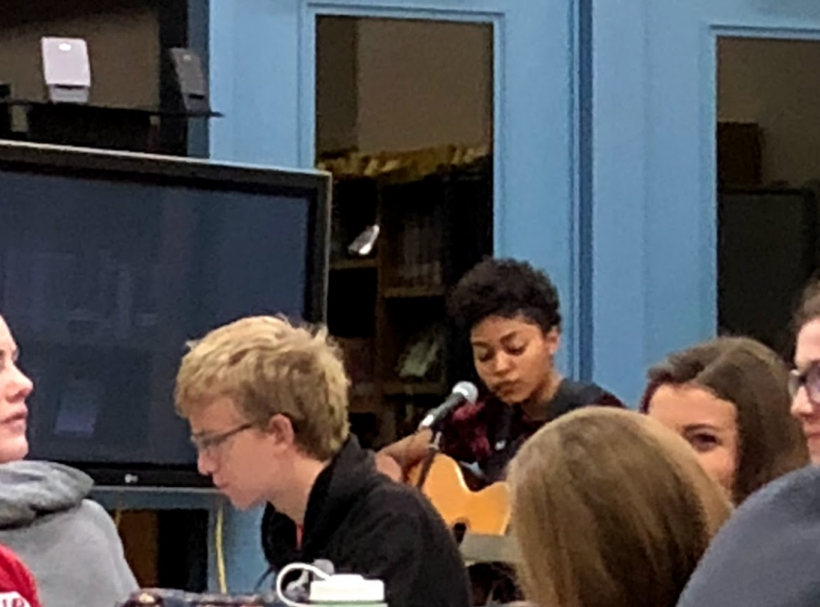Senior Hedessa Henry strums her guitar while singing Demi Lovatos Skyscraper into her microphone in the media center on Oct. 5.
