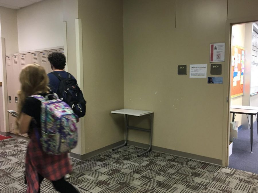 Students walk by B105, unaware of the full history of the room.