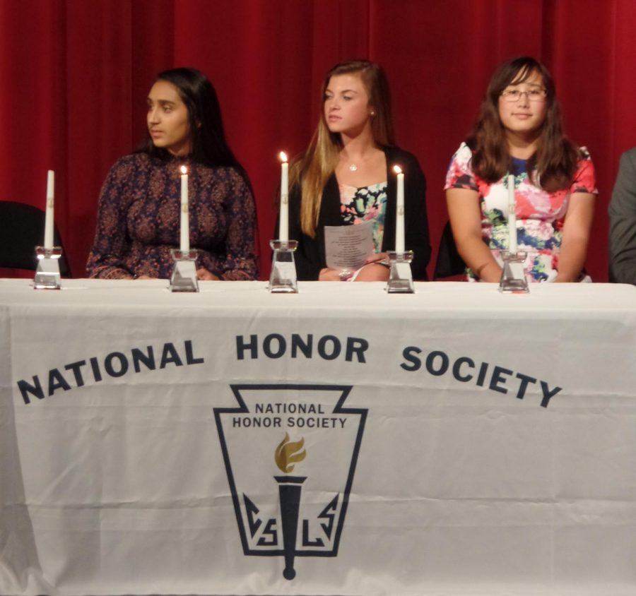 NHS Officers welcome new members during the Oct. induction ceremony of 2017.