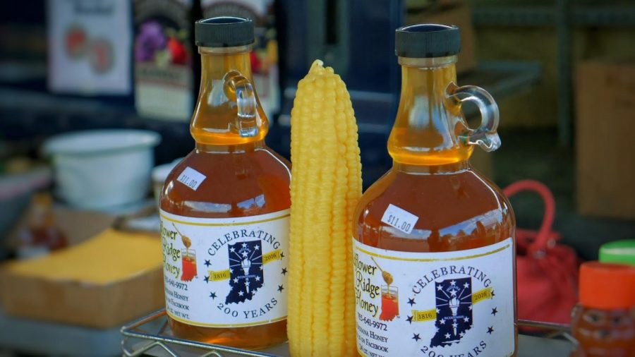 A local vendor displays honey for retail at the Fishers Fall Farmers Market on Saturday Oct. 6.