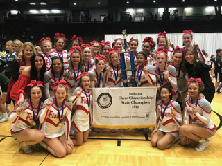 The cheer team stands alongside their state trophy after the awards ceremony on Nov. 4