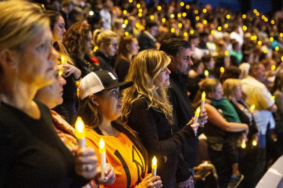 People gather at a candlelight vigil on Nov. 8 to mourn those killed in the Thousand Oaks shooting