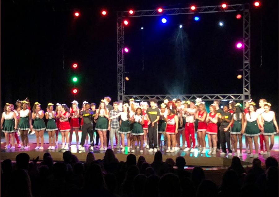 """The cast of """"Bring It On: The Musical"""" cheers along with the crowd as they take their final bows on the closing night on Nov. 17."""