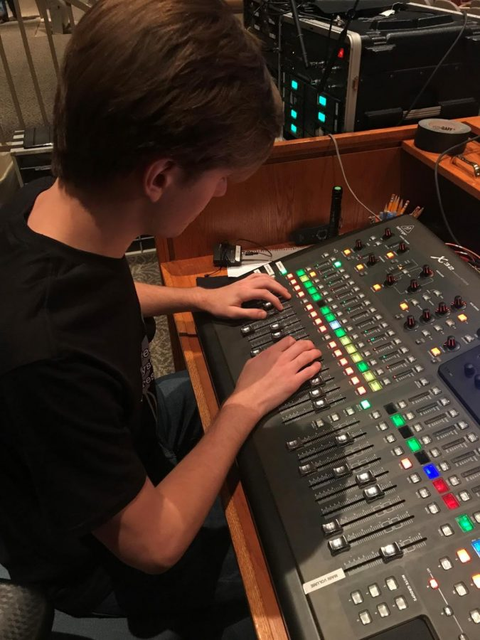 Senior Liam Green sets sound cues for Friday and Saturday  night shows of Bring It On on Nov. 16.