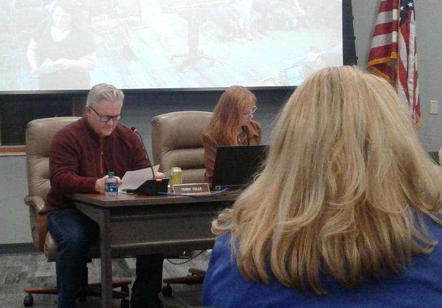 Board members Terry Tolle and Amanda Shera read over a paper one of the speakers handed out which outlined their points at the HSE redistricting final meeting on Dec. 12.