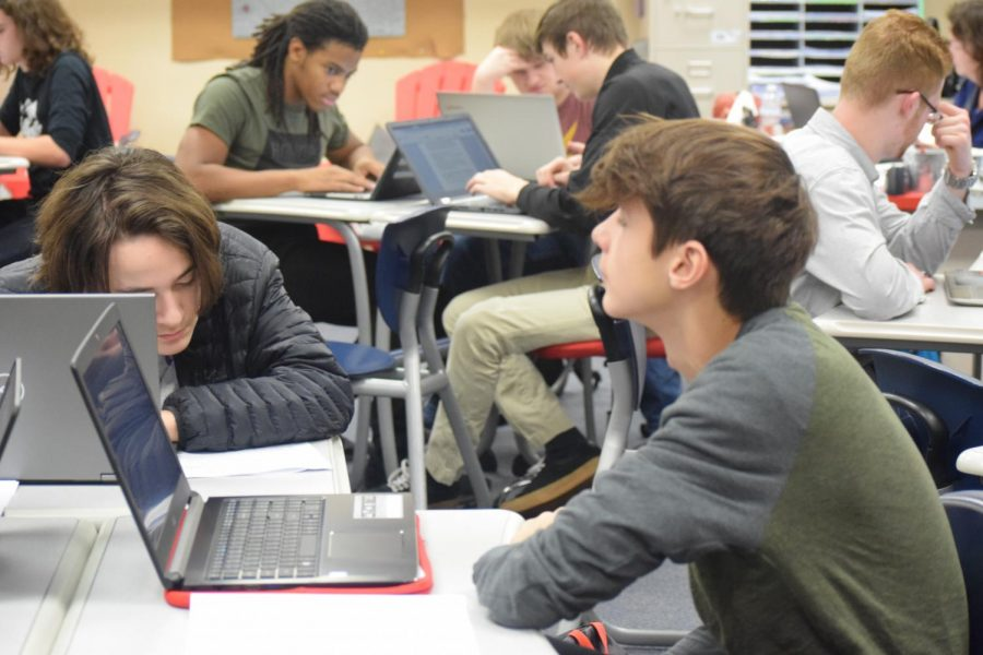Students immerse themselves in study in their AP Literature class.