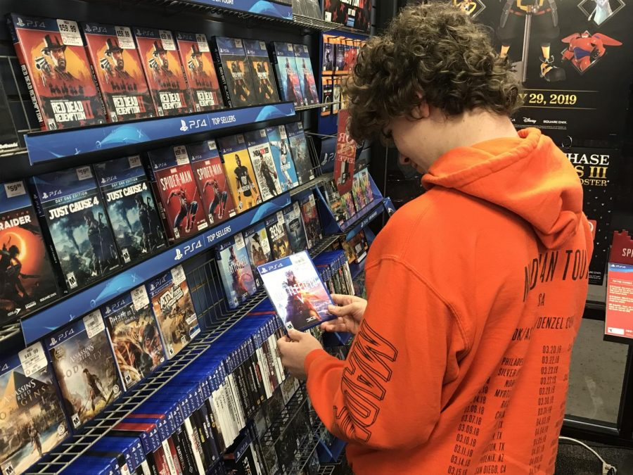 Sophomore Ryan Moore decides whether to buy Battlefield V at Gamestop on Dec. 3.