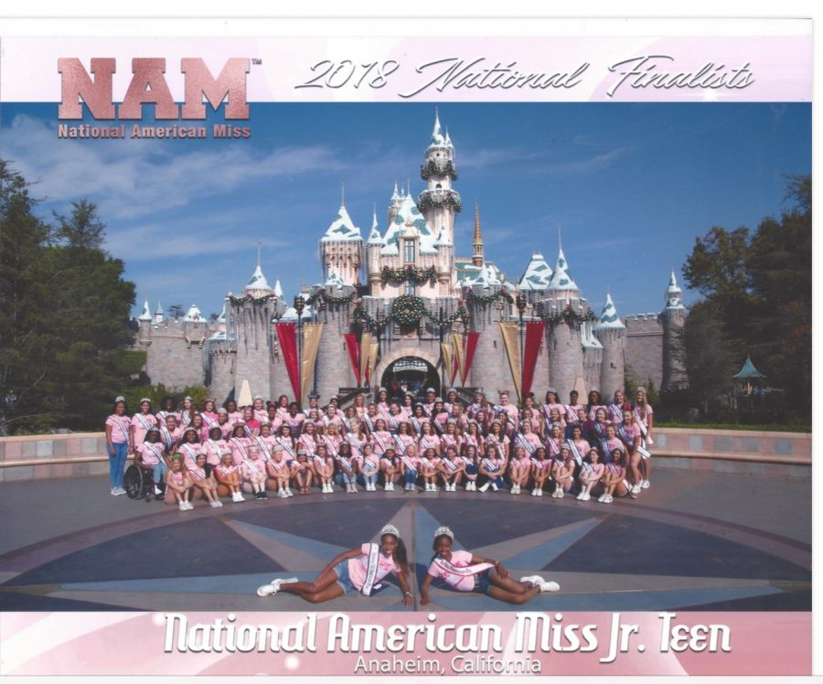 The Junior Teen team poses  for its portrait in  front of Disneyland for their free day in Anaheim on Nov. 21.