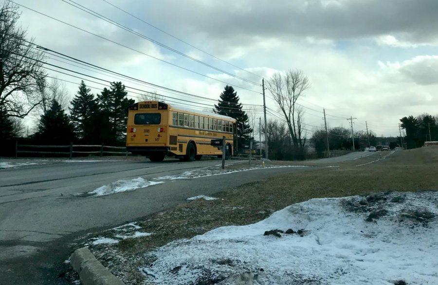 An HSE schools bus leaves Fishers High School along Hoosier Road on Jan. 29 in freezing temperatures.