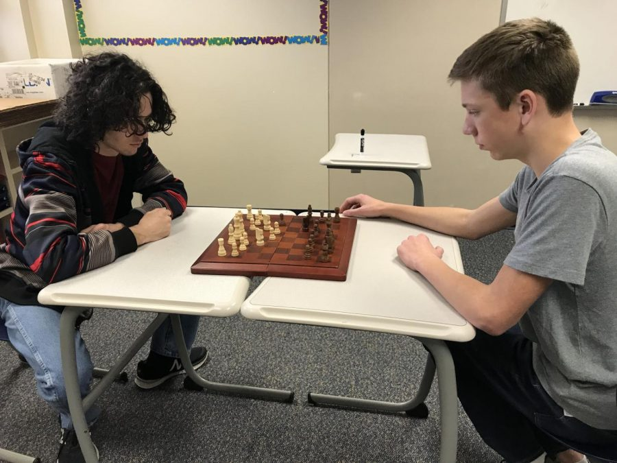 Senior Jacob Frollo and freshman Miles Morosi begin a game of chess at the club meeting on Jan. 17.