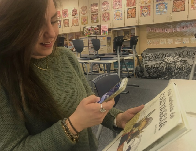 """Spanish teacher Stephanie takes a photo of her Spanish book """"Guía Ilustrada de Cantabria"""" to post on Twitter for her final day of the challenge."""
