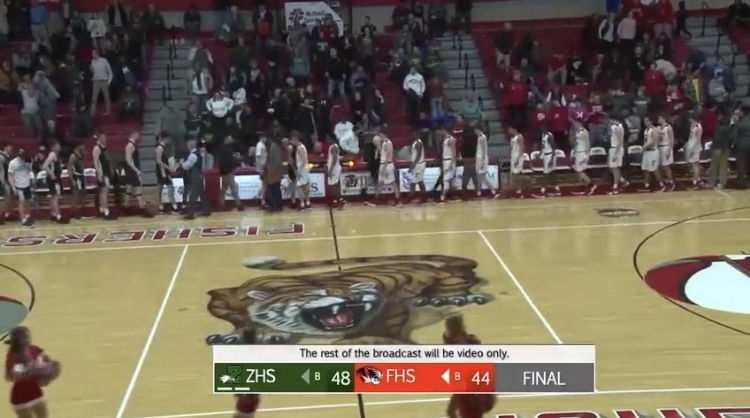 The Tigers and the Eagles shake hands at the end of the conference on Feb. 15. Despite technical difficulties, the Fishers Sports Network streamed the game on Twitter.