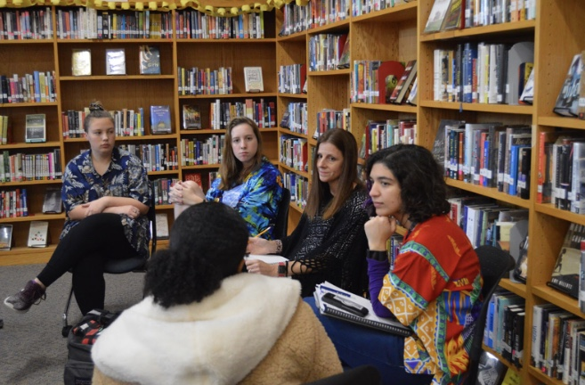 Sophomore Kelsey Ortell, senior Whitney Roberts, and junior Meron Washington discuss equity issues with Mrs. Isom and Mrs. Greco in the Library on Dec. 13. Photo by Quinn Lowry