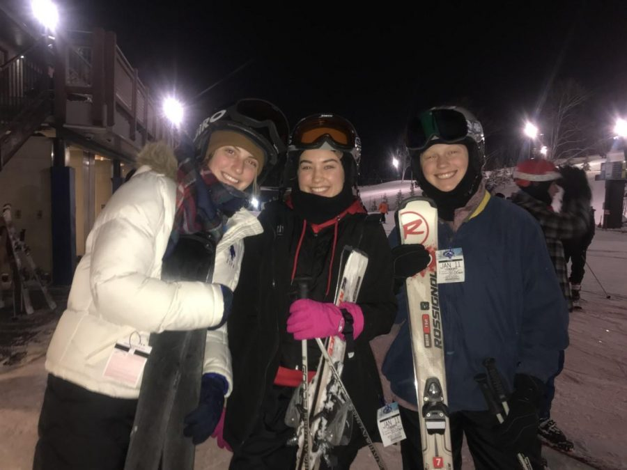 Seniors Makayla Palmer, Gwyn Milikin and Lauren Hege prepare to go down the slopes of the Perfect North Resort.