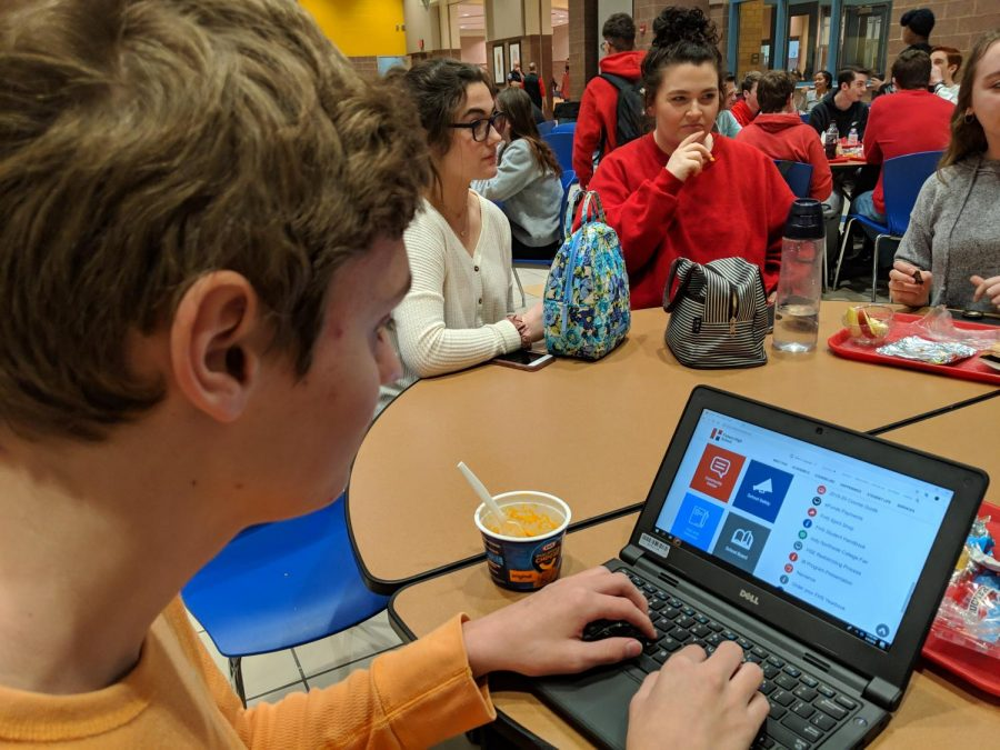 Sophomore Hugh Darrow checks the schedule for the week of spring ISTEP testing on Feb. 4.