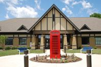 A classic red phone booth in Billericay Park honors Fisherss English sister city.