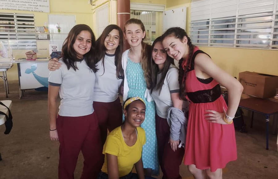 Junior Brynn McCollister (right) poses with friends from Cru on their mission trip in Puerto Rico.