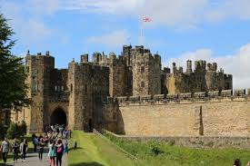 Tourists enter the front gate of Alnwick Castle in Englands Northumberland county.