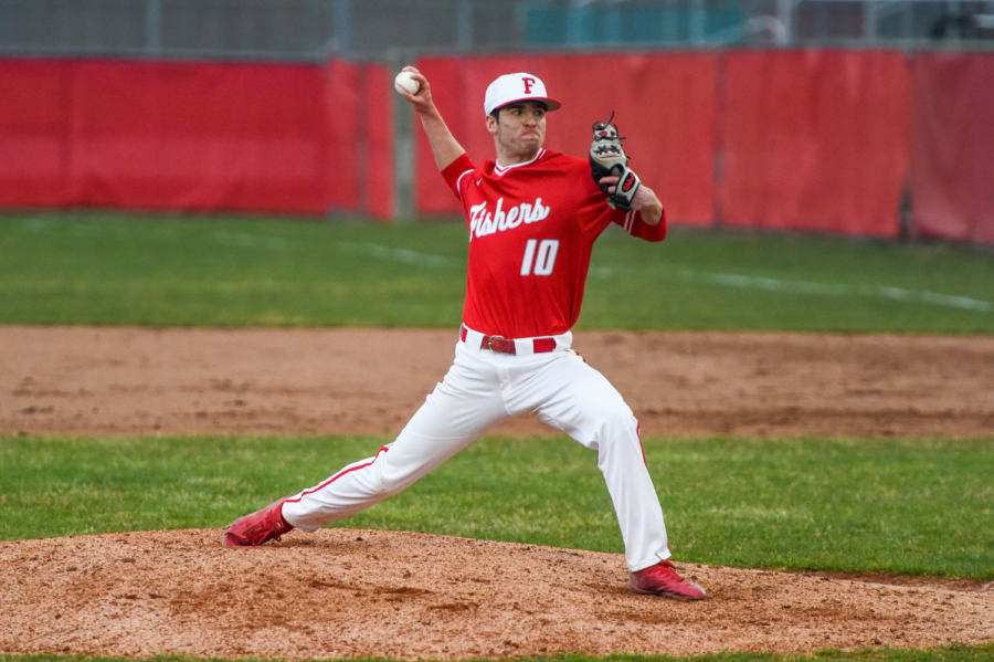 Senior Jack Minns pitches the ball on April 4 against Zionsville at an away game.