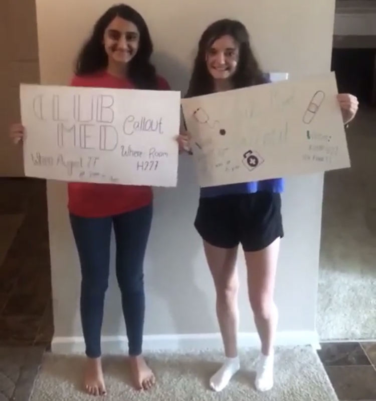 Seniors Sarita Pantula and Emma Burns promote the first club meeting for Club Med.