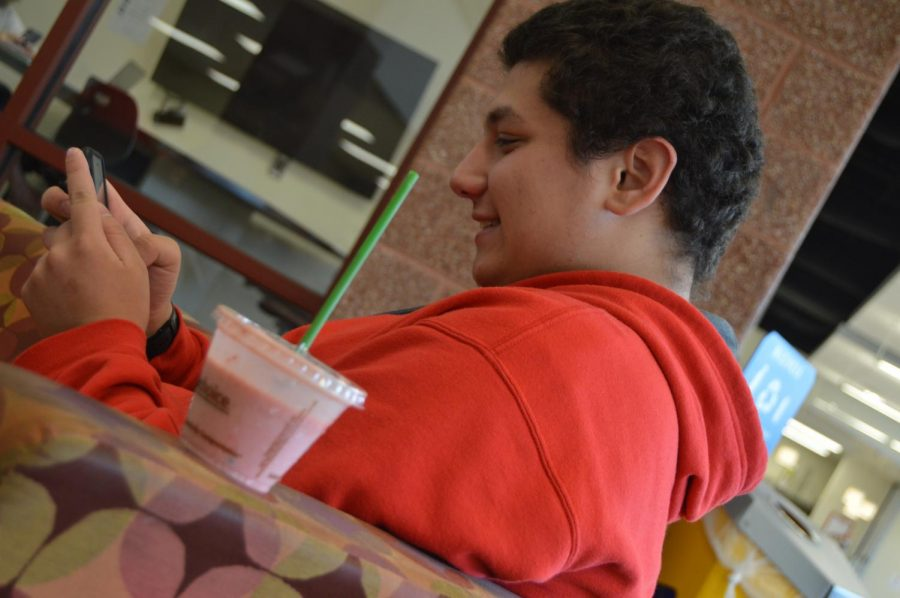 Senior Jared Hyatt drinks a smoothie from the CCA with a plastic straw.