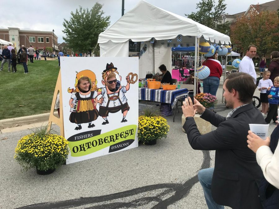 Oktoberfest attendees pose for pictures at the event in 2018.