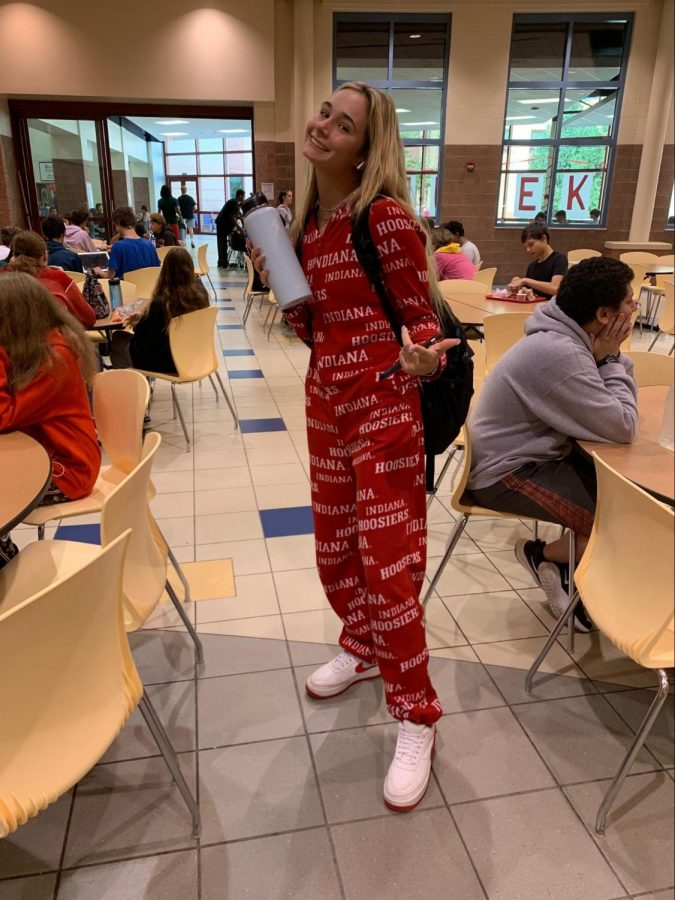 Junior Elle Hines is wearing an IU onesie $40, Nike air forces in red $90, with her baby blue hydro flask $44.95.