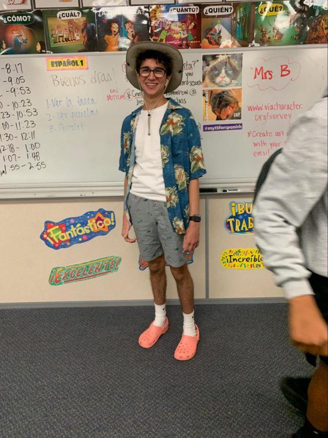 Junior Ethan Lain: white shirt $5, dark blue hawaiian shirt $11, shorts $14.97, Nike socks $10.50, and pink crocs $39.99.