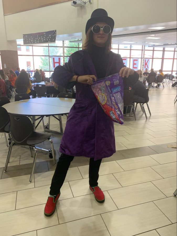 Junior Nealon Jones dressed up as Willy Wonka from Charlie in the chocolate factory, jacket: $31.97, black turtleneck $28, black jeans $24.99, and red and green vans $75.