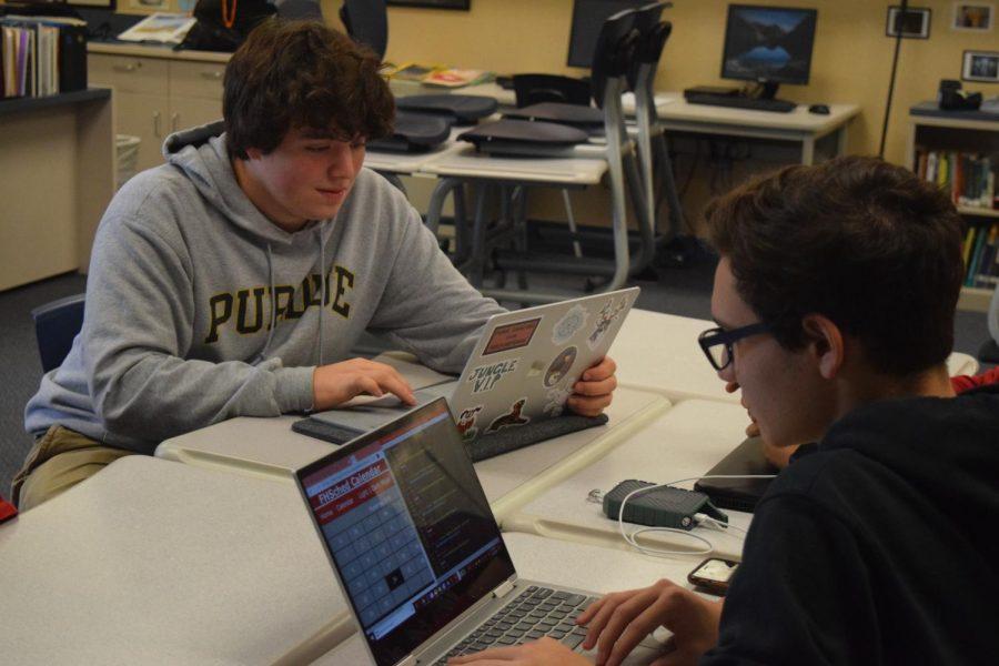 Juniors Ben Lilley and Matt Ghera work on an upcoming calendar for FHSched website during club meeting on Sept. 24.