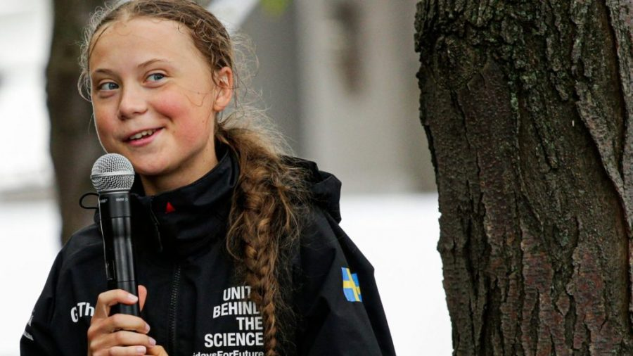 Thunberg addresses a crowd in New York after her voyage across the Atlantic Ocean on a zero-emission sailboat
