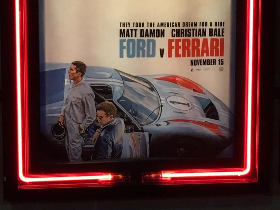 The poster for Ford v Ferrari hangs outside the movie theater.