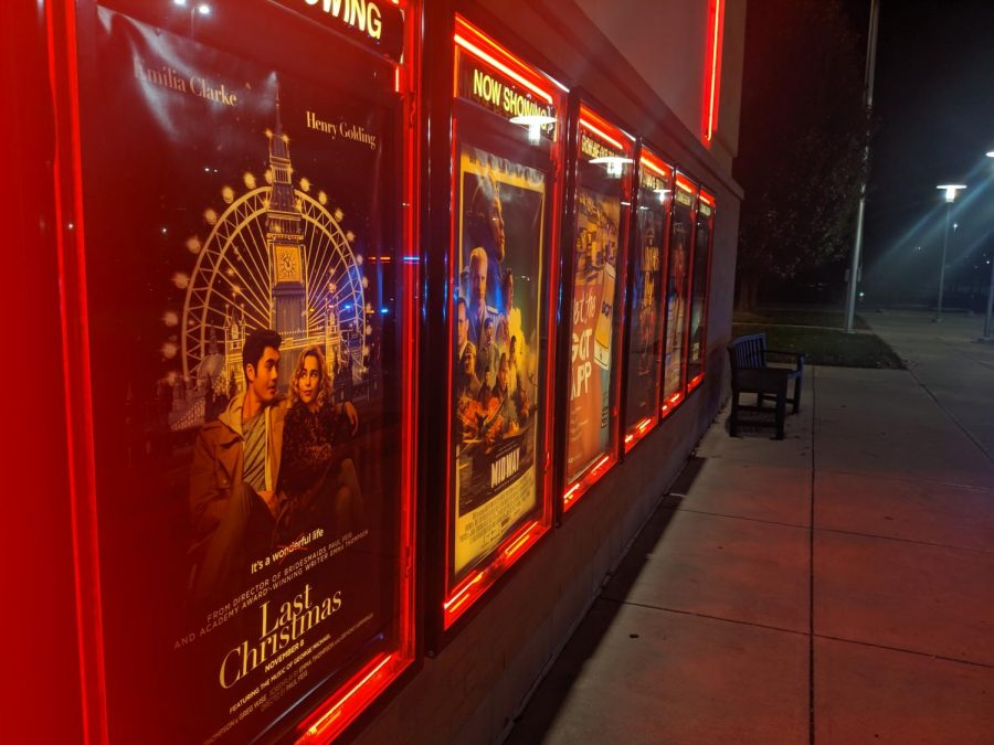 The poster for Last Christmas appears at the local movie theater, along with several others.