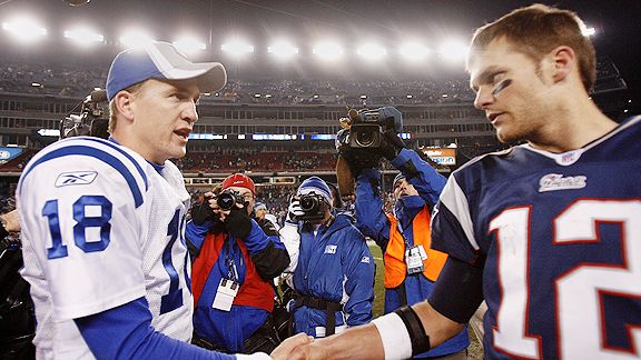 Peyton Manning and Tom Brady show respect to one another following an away game at Gilette Stadium.