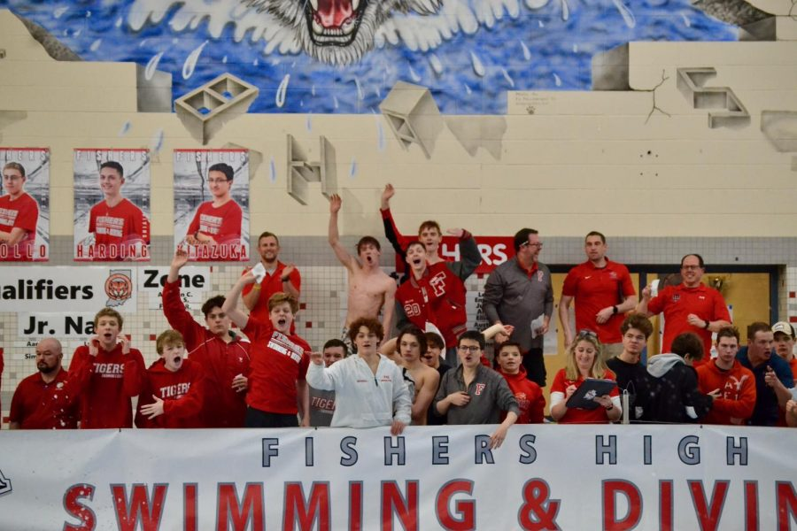Teammates and coaches cheer on the athletes on the final leg of the 200 freestyle relay, as they remain inches ahead of the HSE relay. The FHS relay won first place and set a new school record.