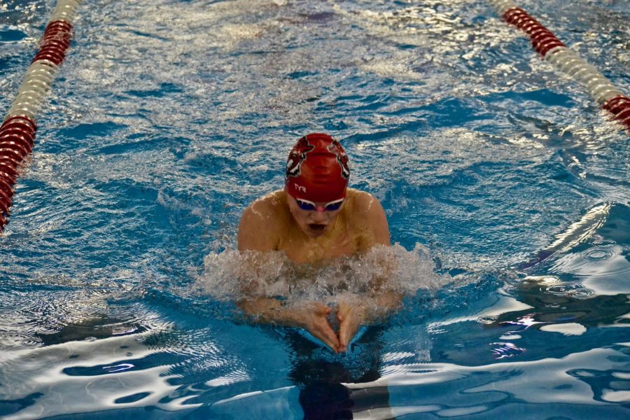 Freshman Dan Bennett prepares for a turn at the wall during the 100 breaststroke. Bennett tied with another FHS swimmer for fifth place